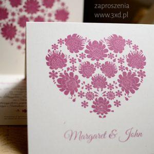 Zaproszenia ślubne ze stylizowanym sercem i motywem łowickich wycinanek